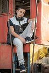 Bar Mitzvah boy sitting on train