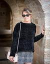 fashion model posing under arch at Ein Kerem