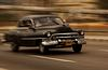 Classic Car Speeds Along The Malecon