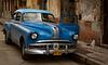 Classic American Car with Curious Cat in Havana