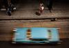 Elevated view of speeding car in Havana Cuba
