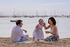 Feeding love.  Family photoshoot at Puerto Pollensa. Mallorca. Balearic Islands.