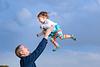Jump and laugh. Family photoshoot at Puerto Pollensa. Mallorca. Balearic Islands.