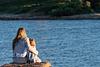 Mom and daughter hug. Family photoshoot at Alcanada Beach Park. Mallorca. Balearic Islands.