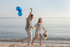 Beach run and blue balloons. Couple Photoshoot at the beach. Son Serra de Marina, Mallorca