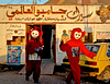 Teletubbies out to distribute promotional fliers for a local circus. Outskirts of Damascus.