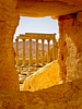 Roman ruins as seen through the now-destroyed Temple of Baal. Palmyra.