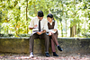 boy and girl studying in park