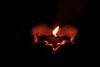 Holding diya in hand during diwali
