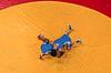 Aerial shot of two wrestler wrestling