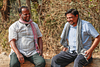 Two farmer discussing and laughing