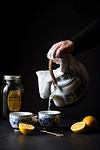 Pouring ginger lemon tea from a vintage tea pot.