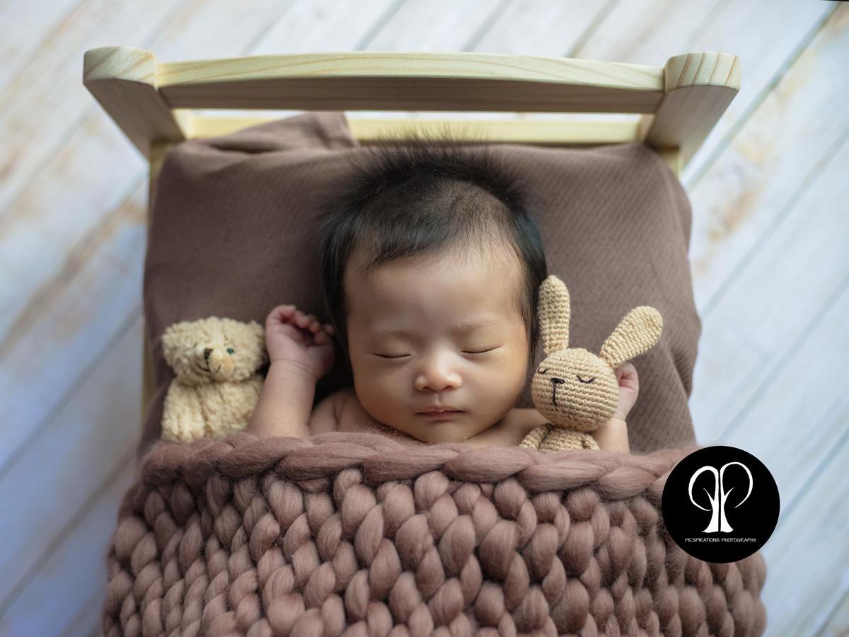 Creative newborn portraiture