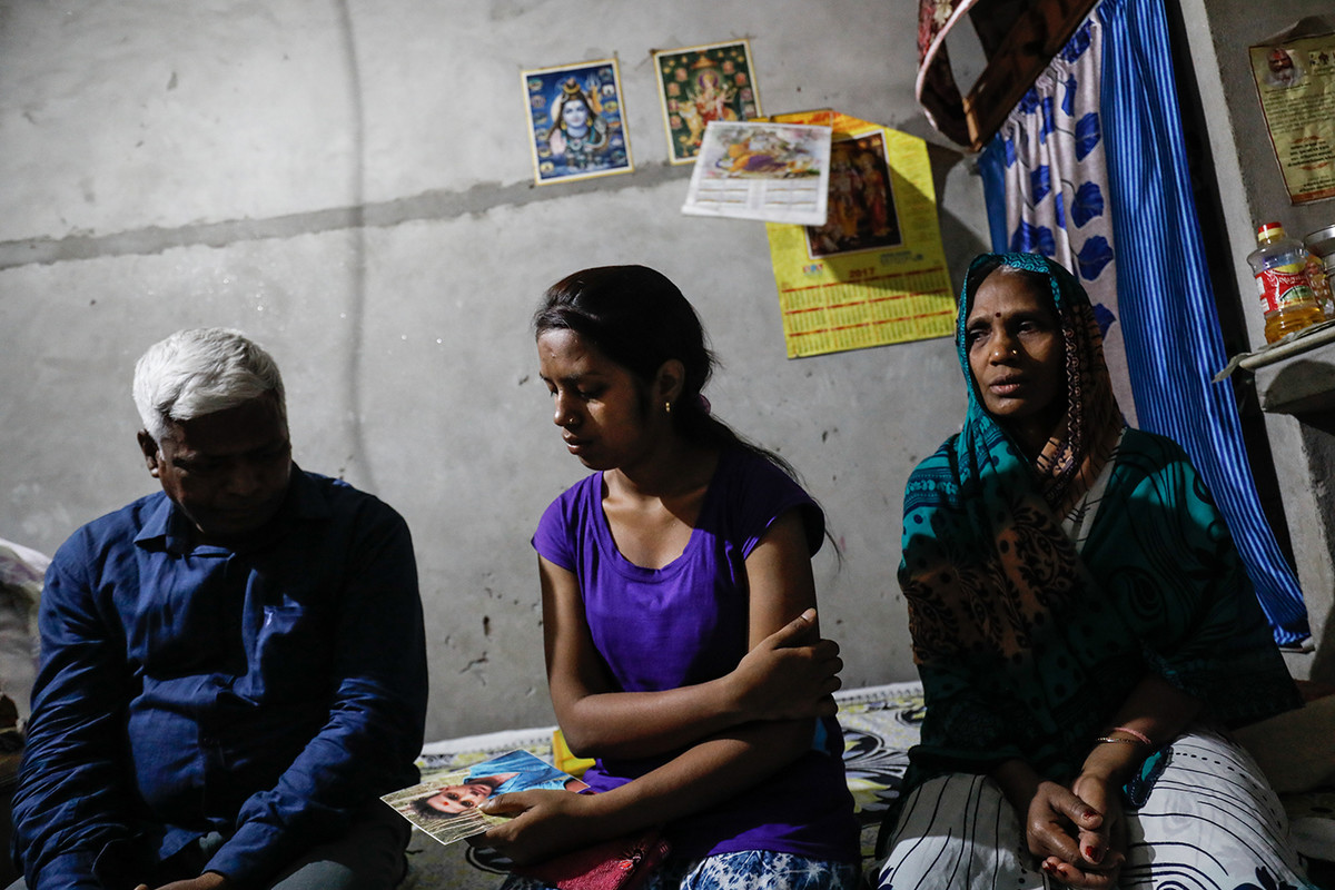 L-R Mahipal Singh, father; Neha Singh, sister; and Rammurti Singh, mother; of 19 year old Abhishek Choubey, who lost his life in a collapse at Ghazipur landfill which occured on Sept 1, 2017, visibly sad talk about their son at their house in New Delhi, India.