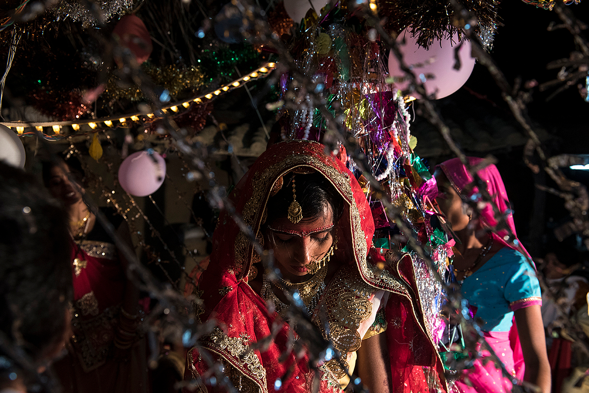 As part of the ceremonies Muskaan* walks around the fire followed by the groom on their wedding day. One in four girls in Shravasti, is married before she turns 18 years of age.