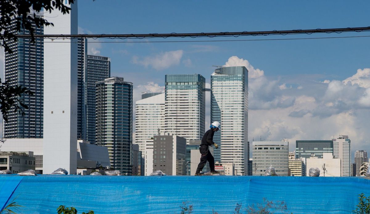 This man is working on the foundation of the Olympic Village