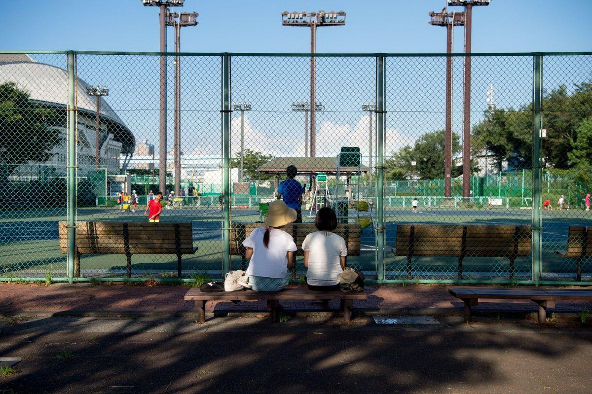 2 women enjoying tennis in the beautiful park