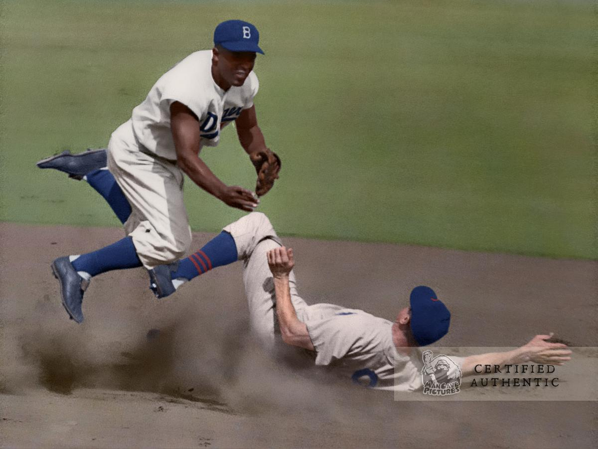 Jackie Robinson turns two by making an acrobatic throw after forcing out Chicago Cubs' Hank Sauer (1952 NL MVP)