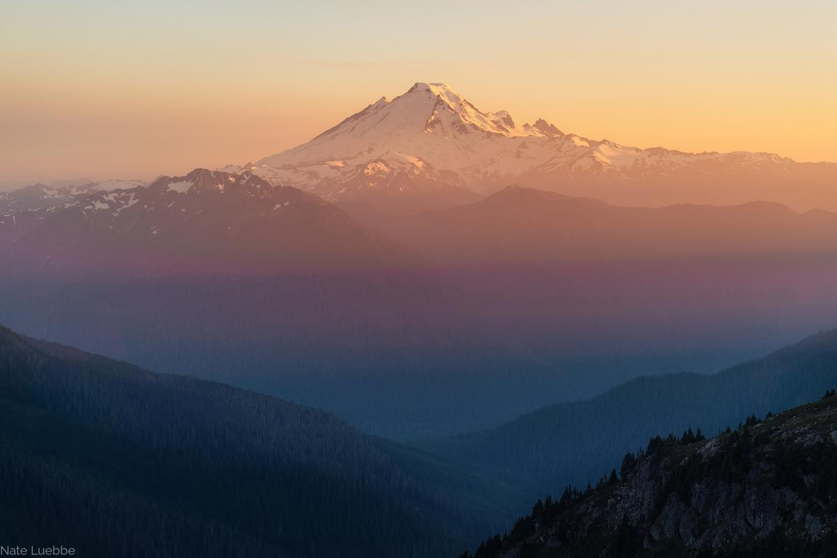 Golden sunlight and alpenglow on Mount Baker, North Cascades National Park