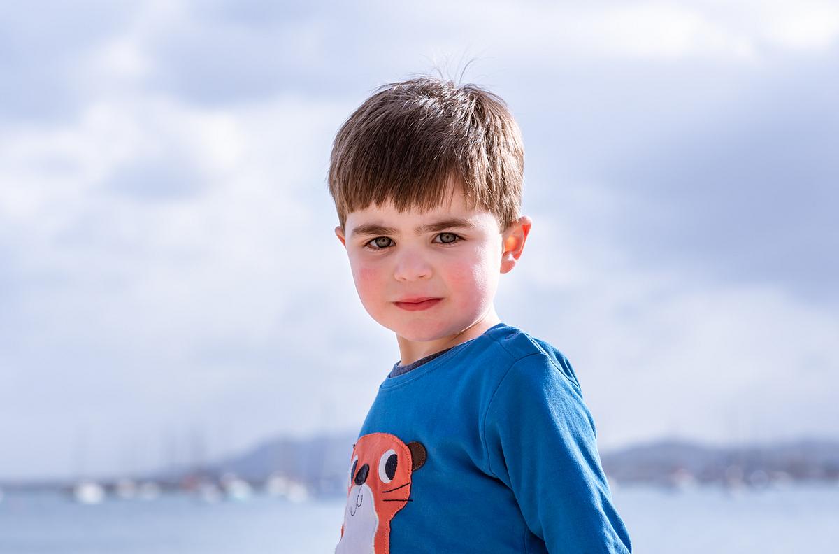 I'm a serious boy. Family photoshoot at Puerto Pollensa. Mallorca. Balearic Islands.