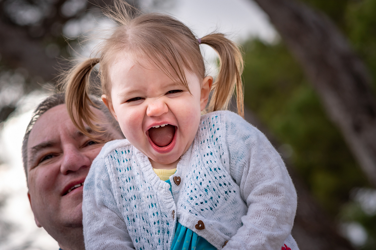 Laugh-out-loud. Family photoshoot at Puerto Pollensa. Mallorca. Balearic Islands.
