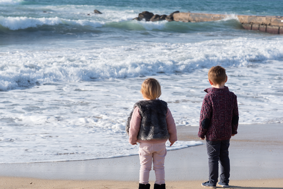 Brother and Sister. Family photoshoot at the beach. Palma de Mallorca. Balearic Islands.