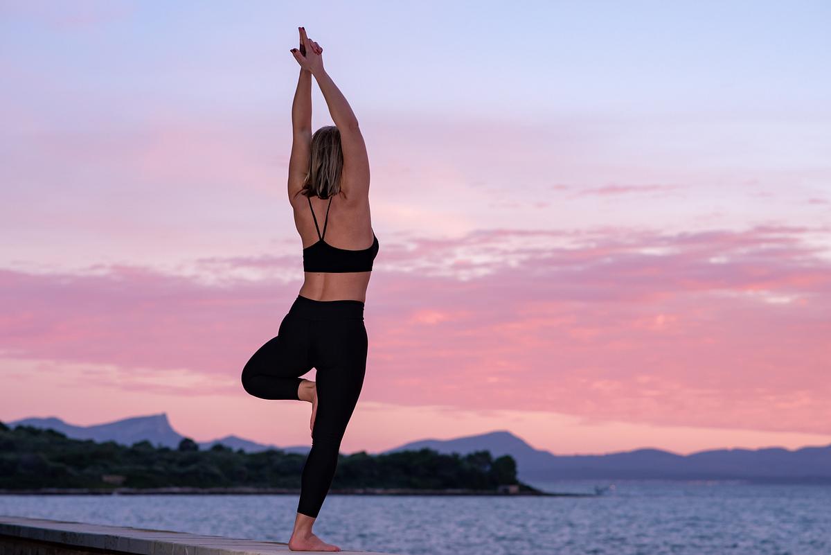 Twilight Yoga. Portrait session at Alcanada beach park. Alcudia. Mallorca. Balearic Islands
