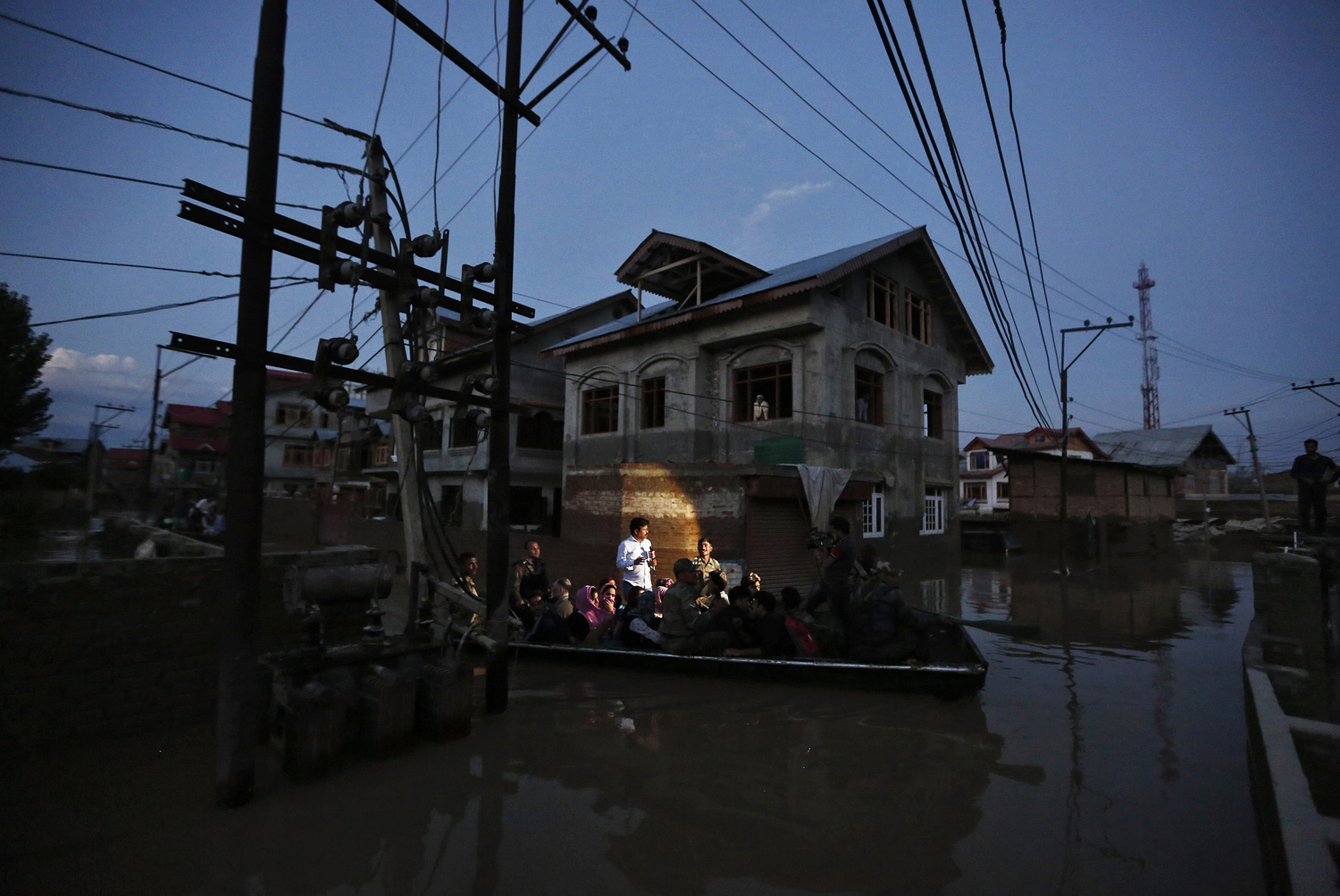 Flood victims are evacuated by boat from their flooded house in Srinagar