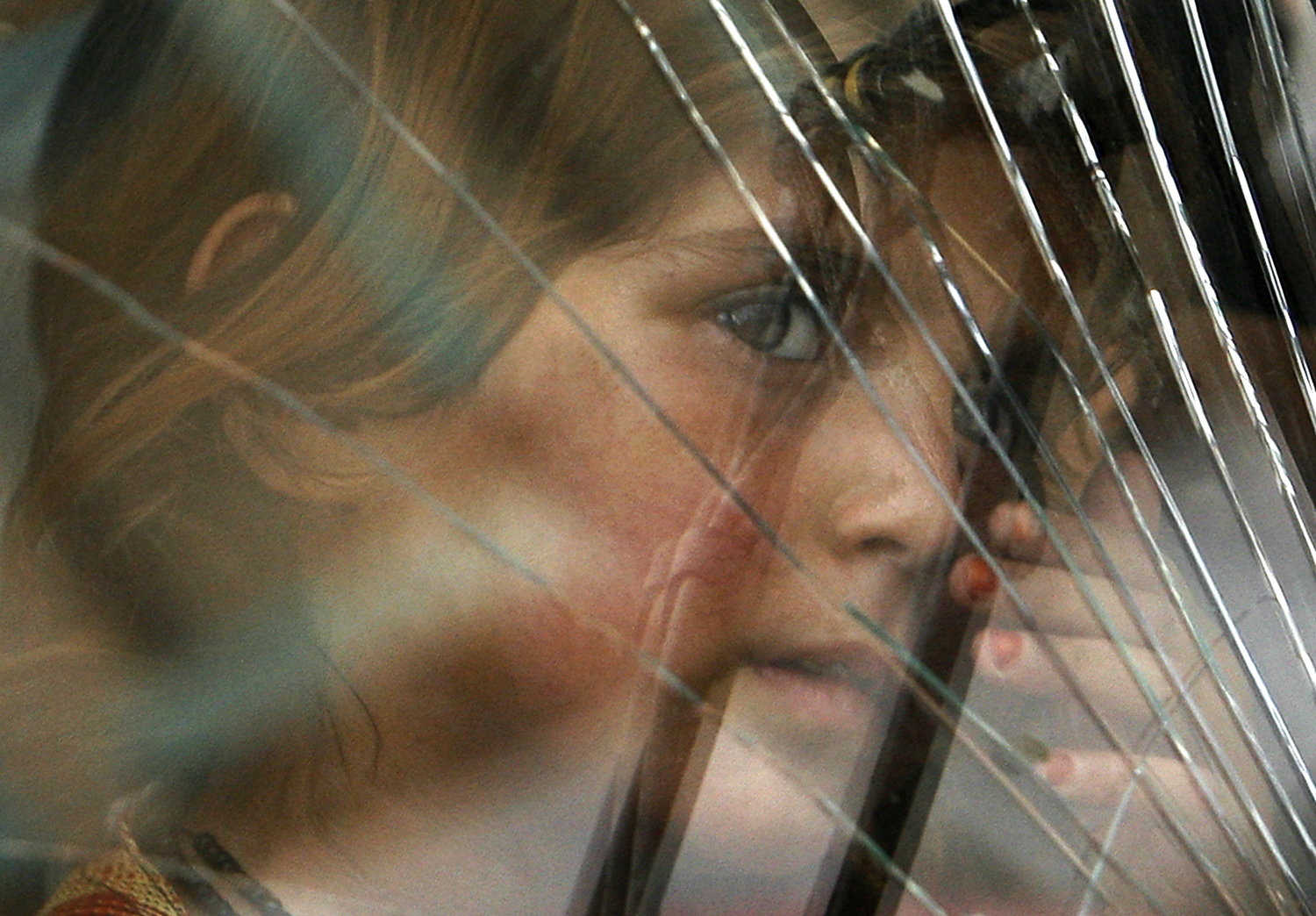 A girl looks out the window of a bus in Kabul