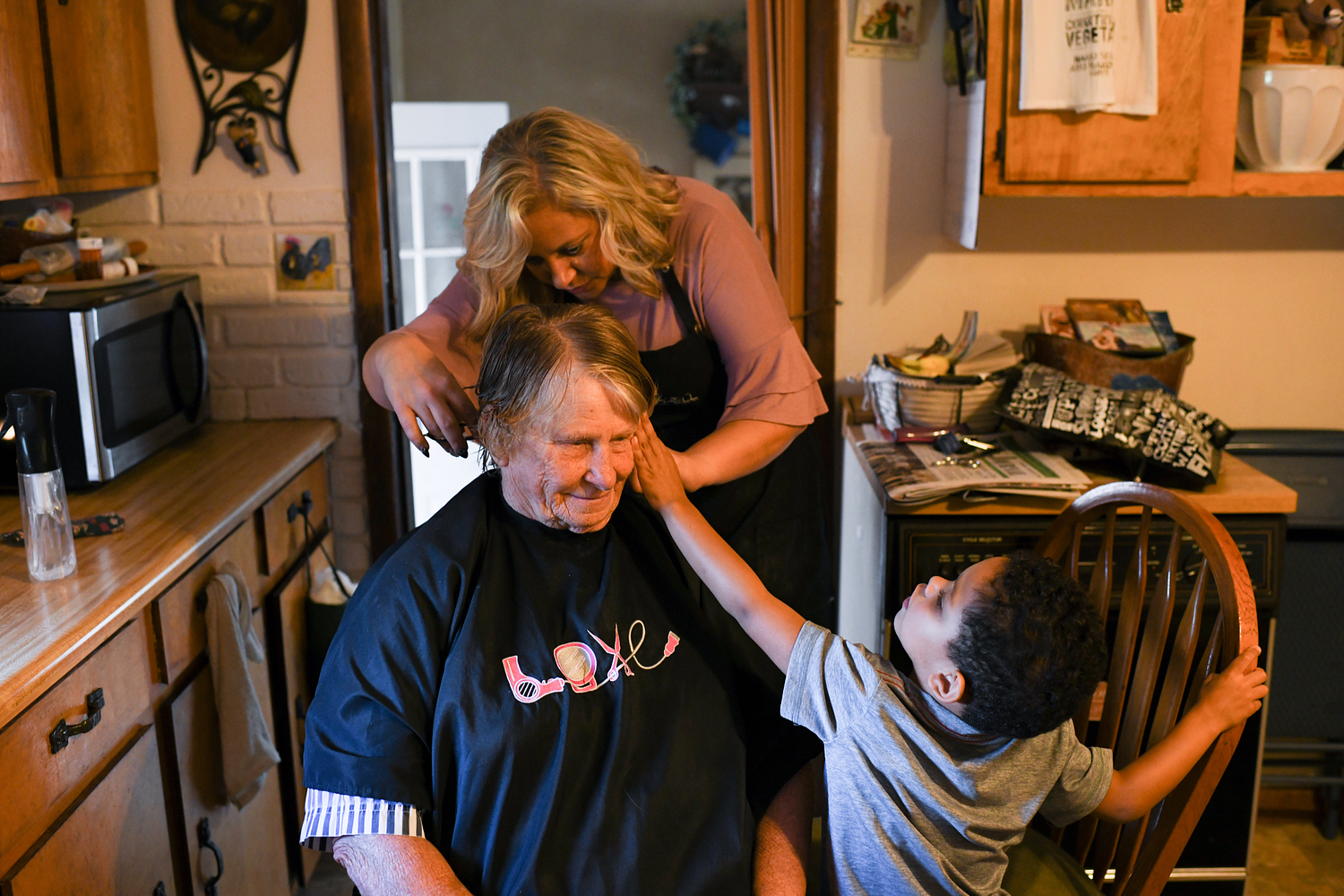 MPW70: Anneliese gives her great grandmother Audra Jackson a haircut at their house in Mountain Grove. Trained as a cosmetologist, Anneliese, 35, co-founded her hair salon, The Shop, with her friend Tana Byerly two years ago.