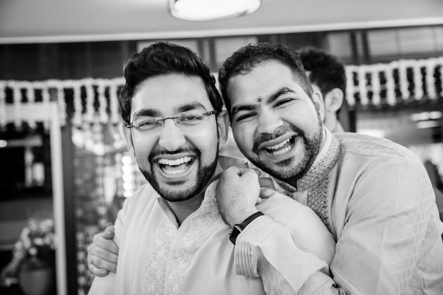 Happy brothers at haldi indian ceremony