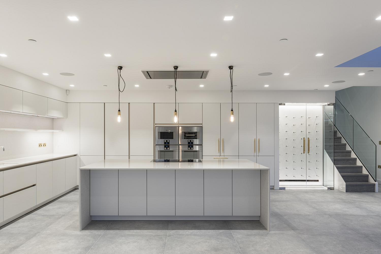 Contemporary white kitchen with brass details, Surrey