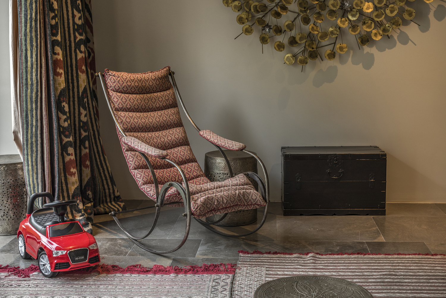Lounge detail with stone floor and rugs, London