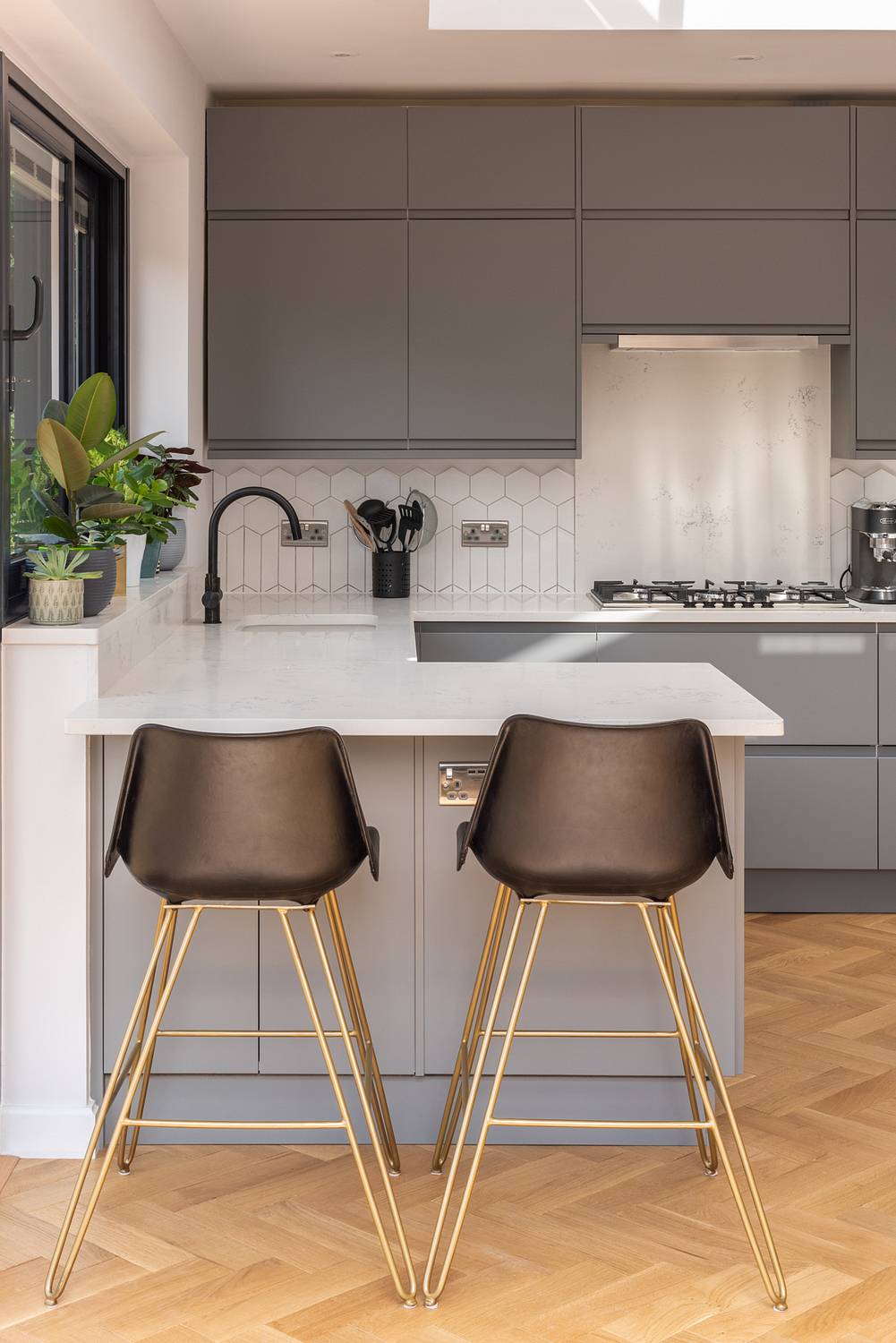 Kitchen detail with bespoke bar stools, London