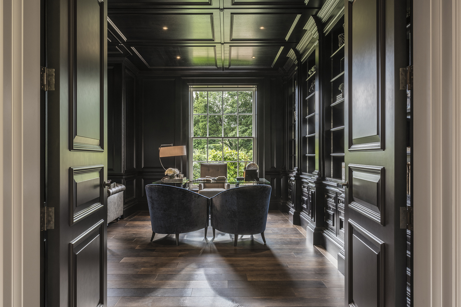 Study with dark wood panelling, Surrey house