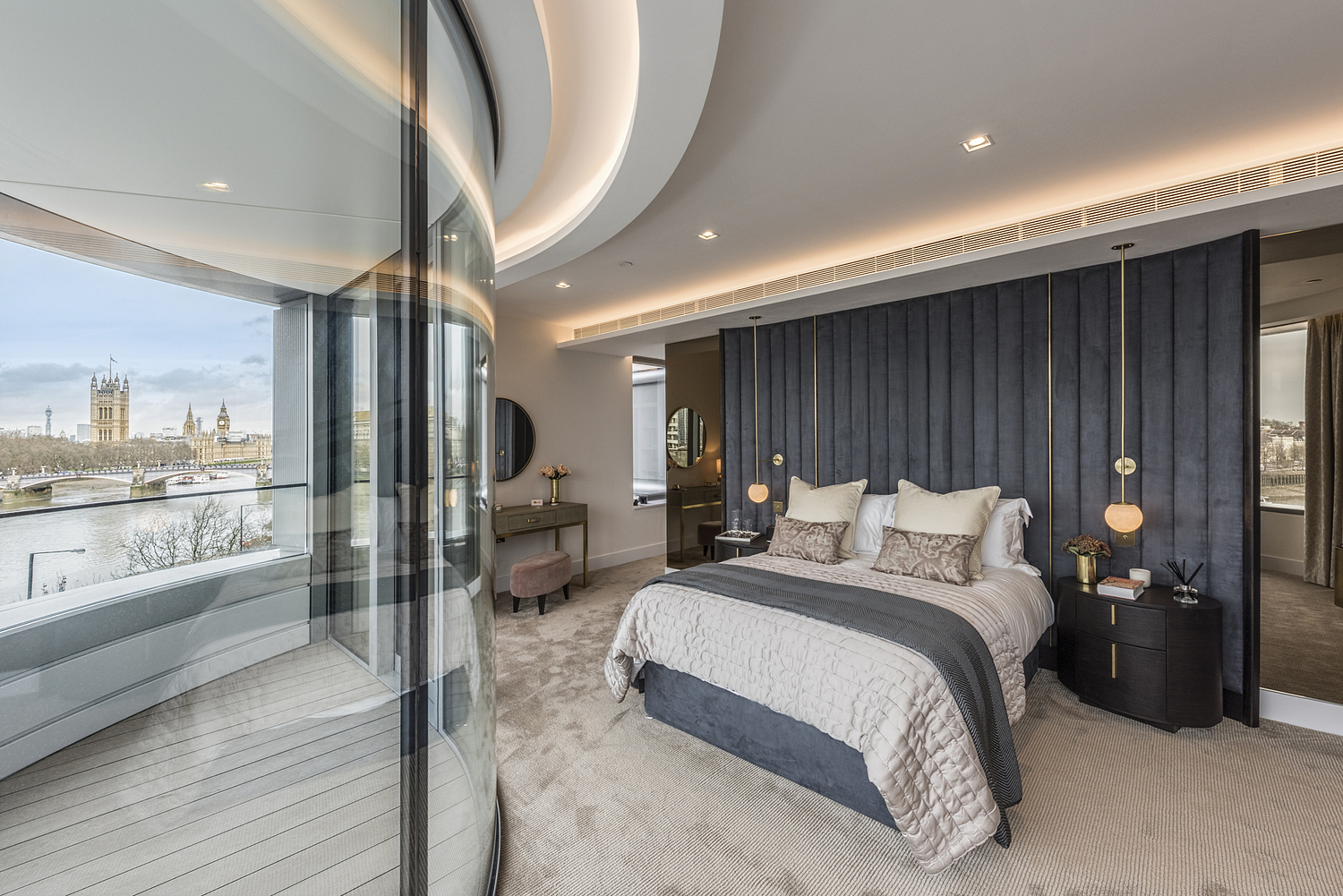 Bedroom detail with view of Parliament, London apartment