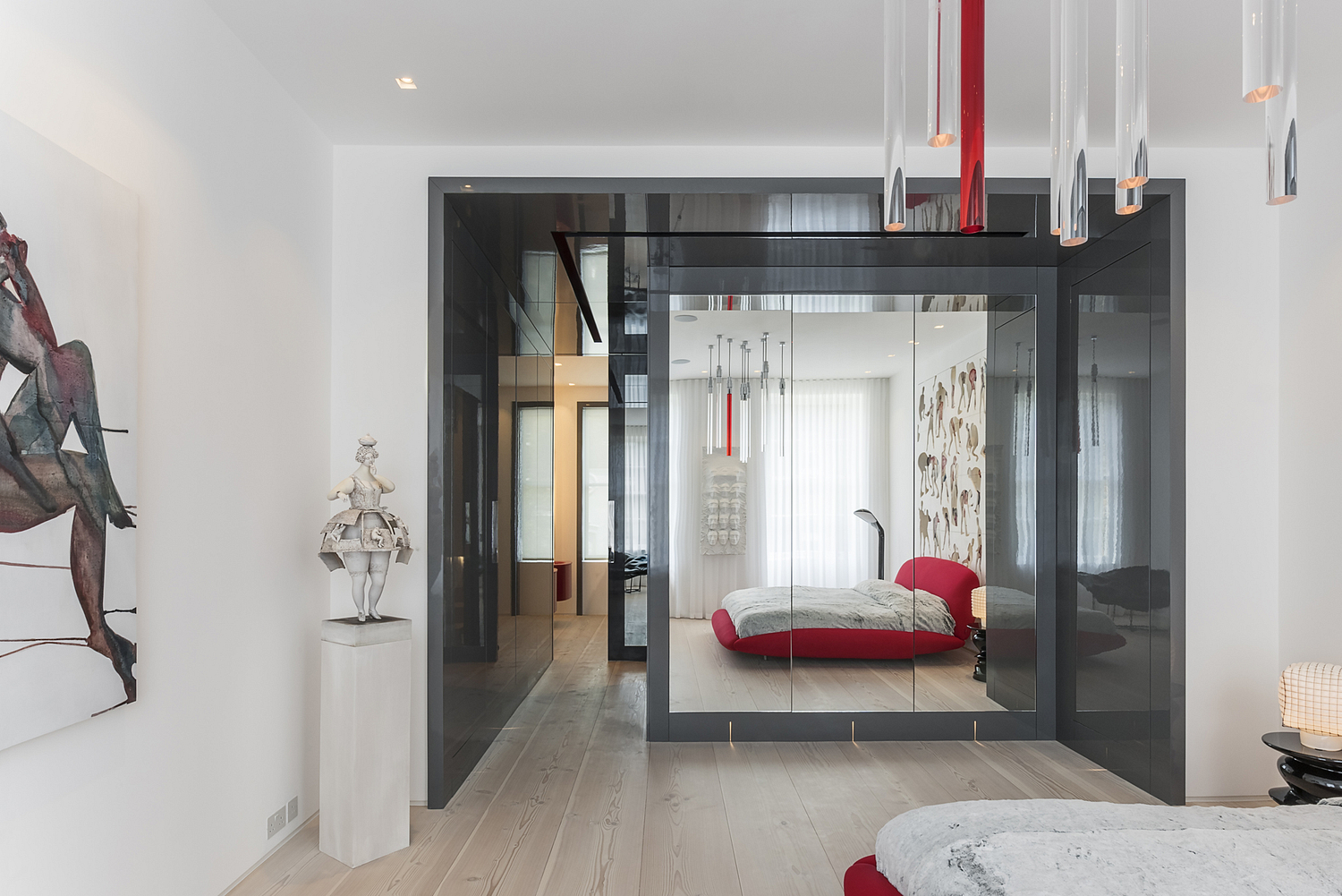 Bedroom detail with large mirror, London