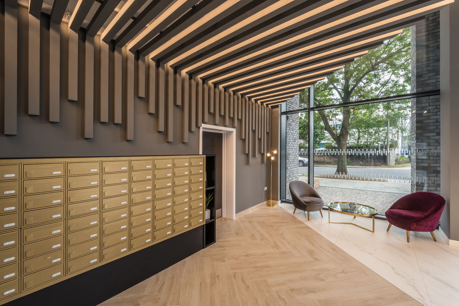 Concierge area with brass lockers, London