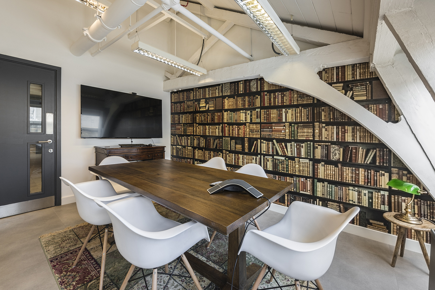 Conference room with library wallpaper, workspace, London