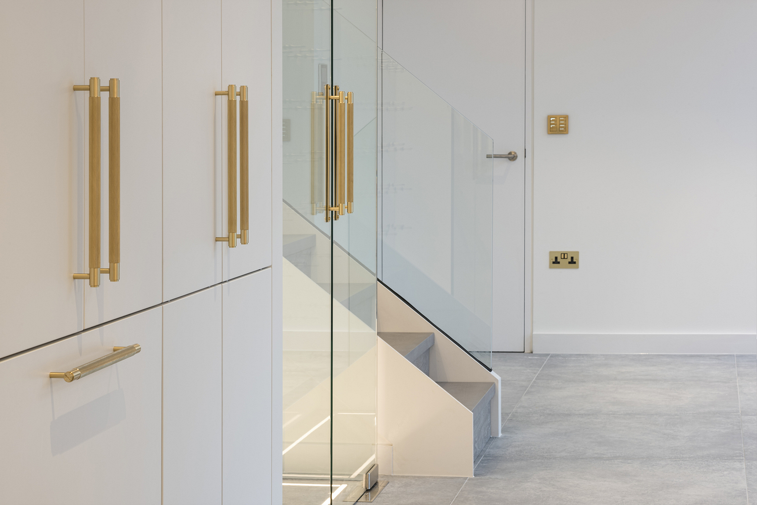Brass knurled cabinet handles, contemporary kitchen, Surrey