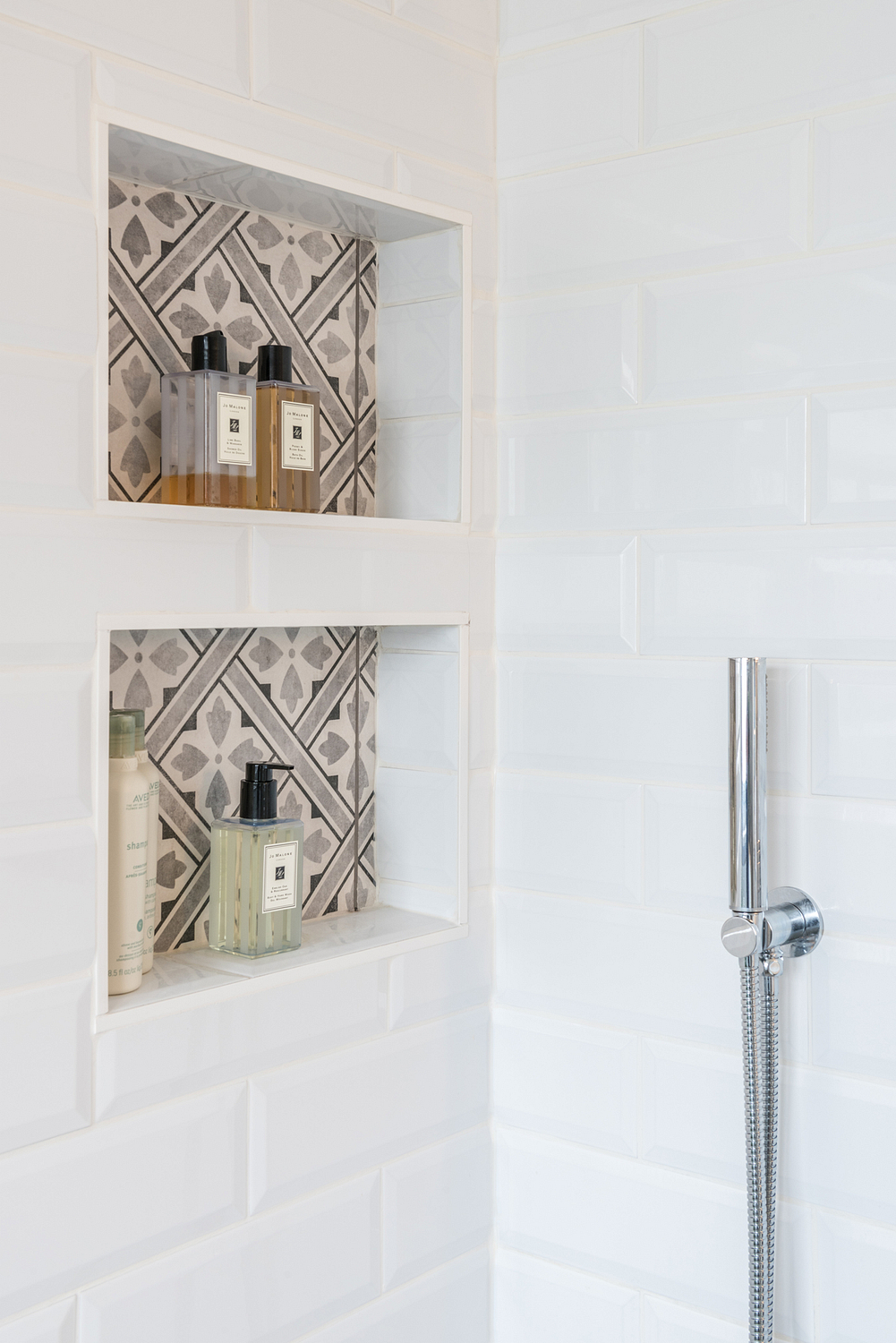 Shower shelf detail with printed tiles, London