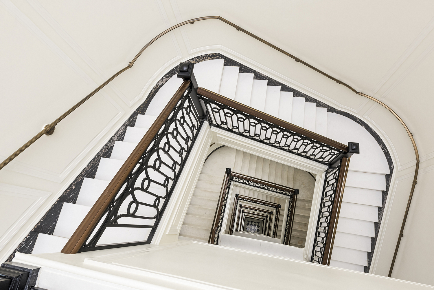 Staircase view with bronze handrail, Washington DC