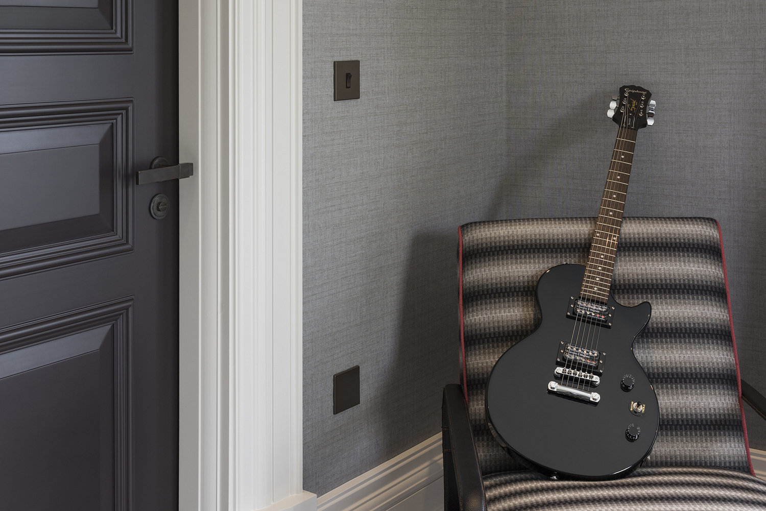 Bedroom chair with guitar, London