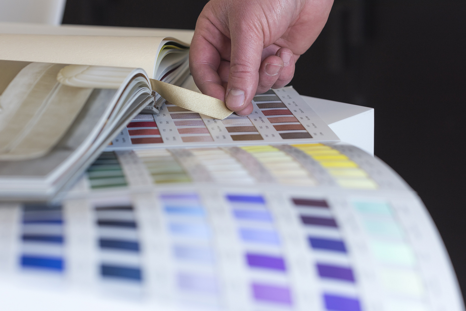 Colour swatch detail with hand, London
