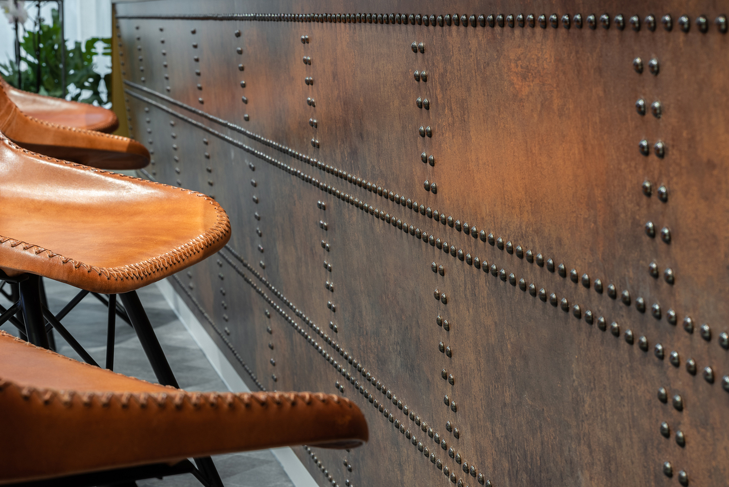 Rust effect reception desk detail with studs