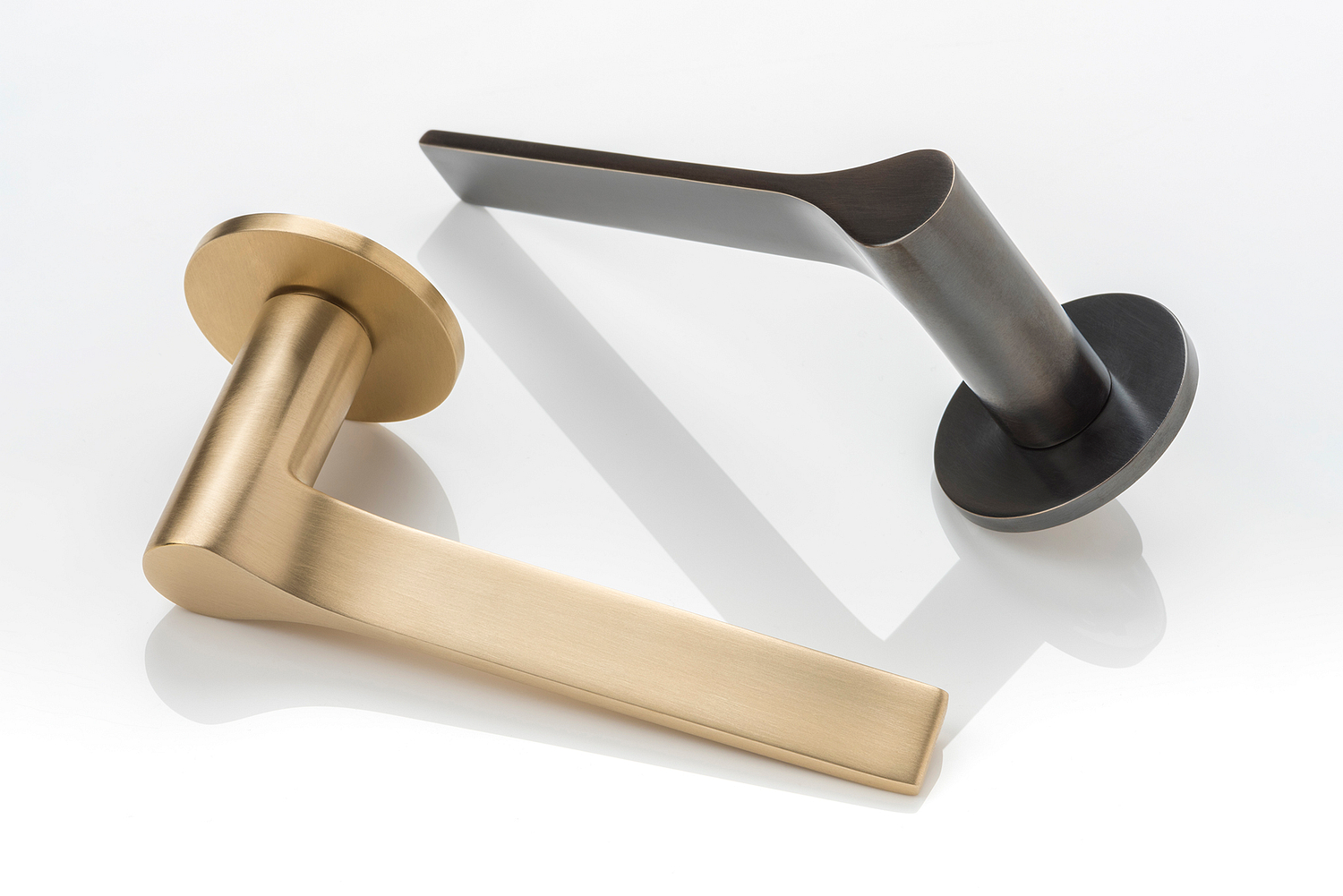 Bronze and Satin Brass lever handles, Joseph Giles, London