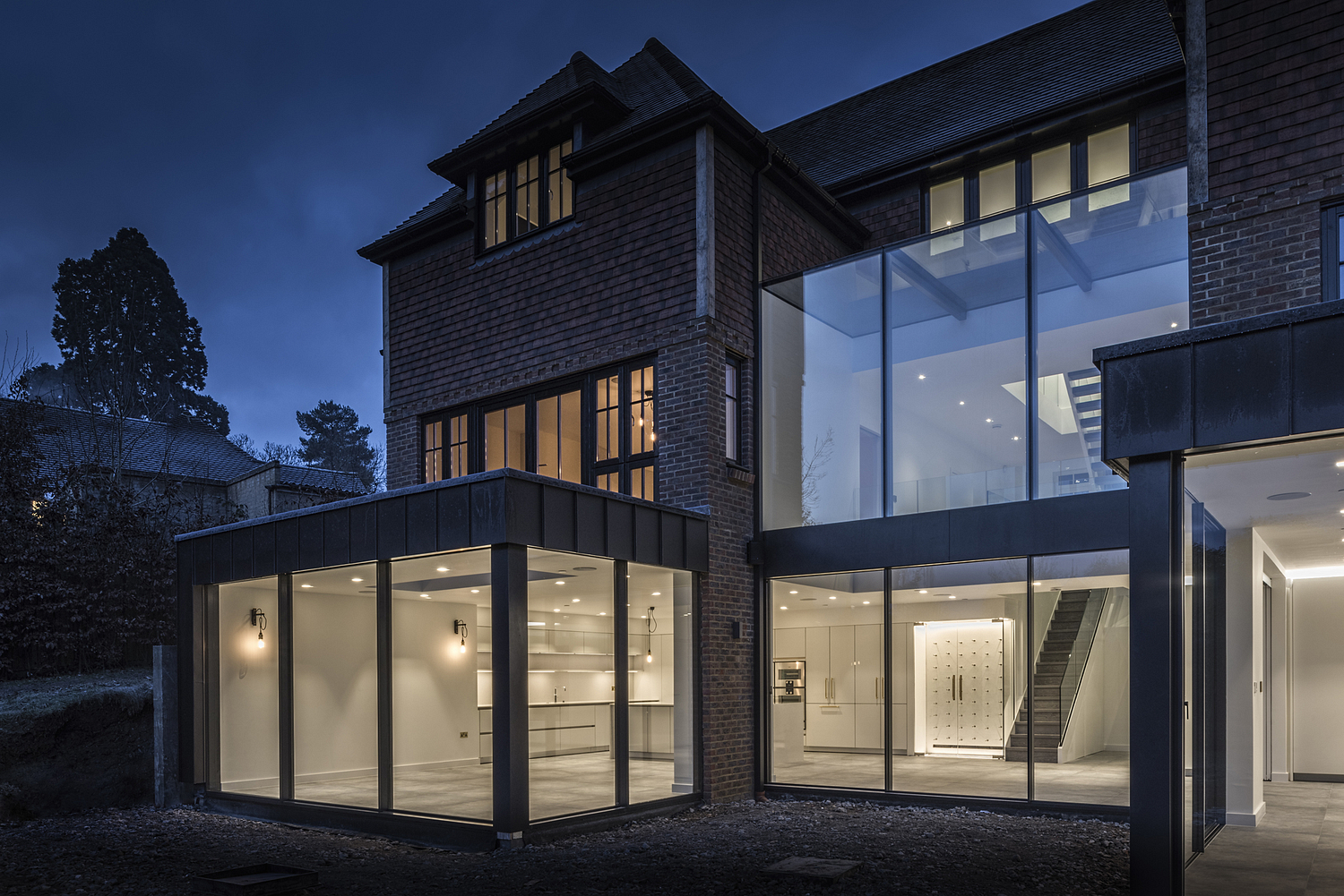 Contemporary renovation at night, Surrey