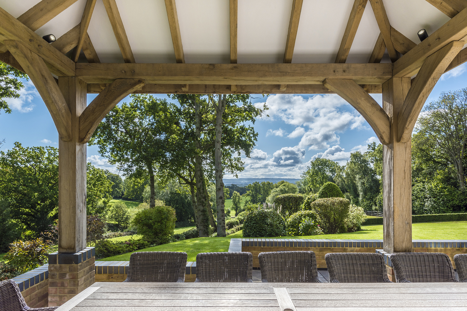 Country house view from garden outdoor dining area, Surrey