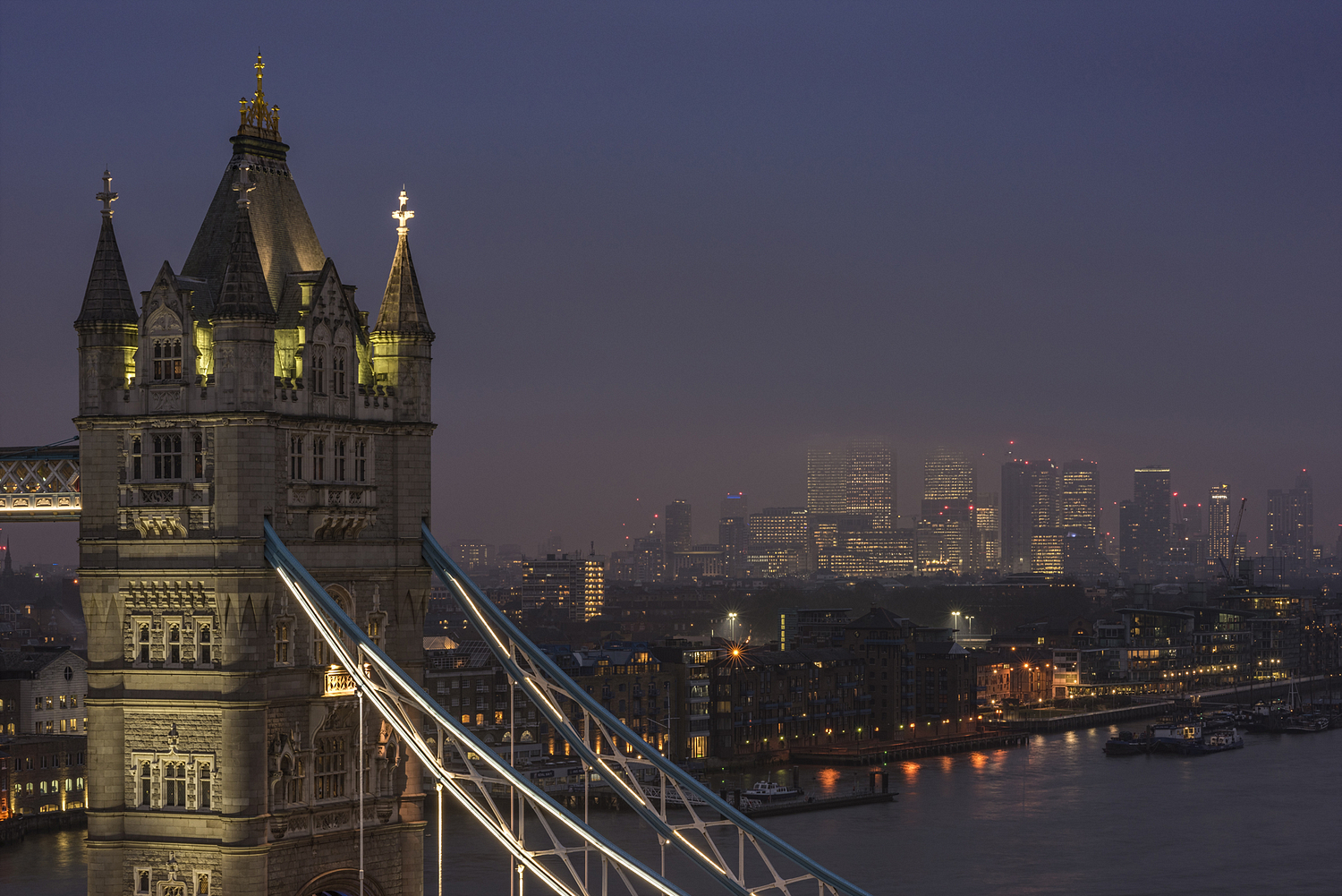 Tower Bridge detail and London skyline at night