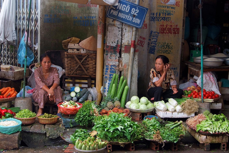 Vendors at a Hanoi Street Market Stall